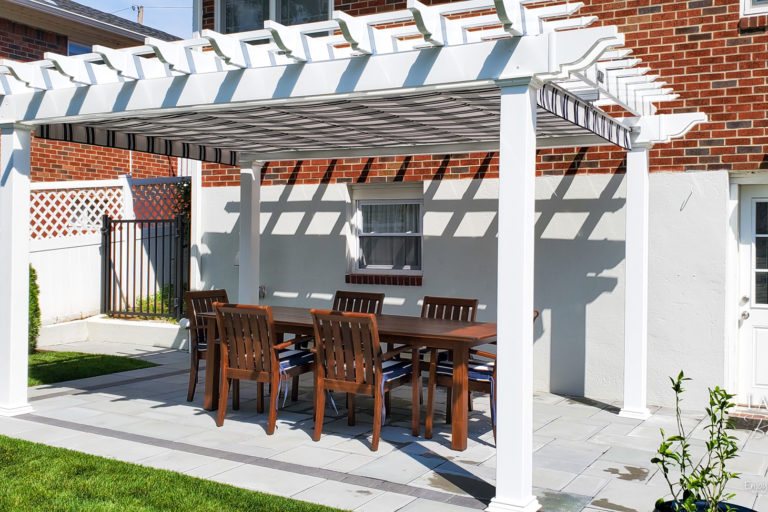 vinyl backyard patio pergola featuring navy taupe fancy shad can