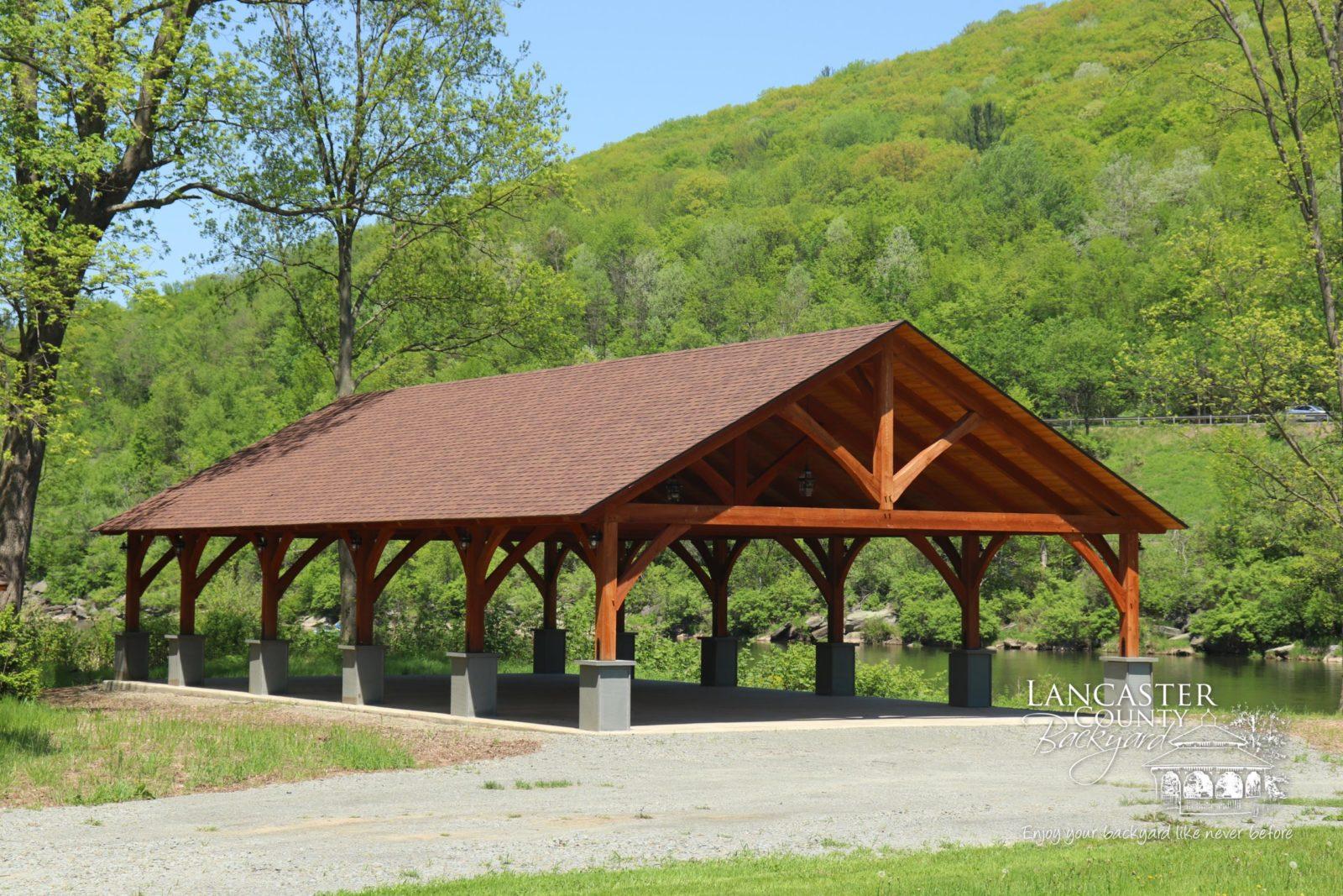 timber frame pavilion in a park