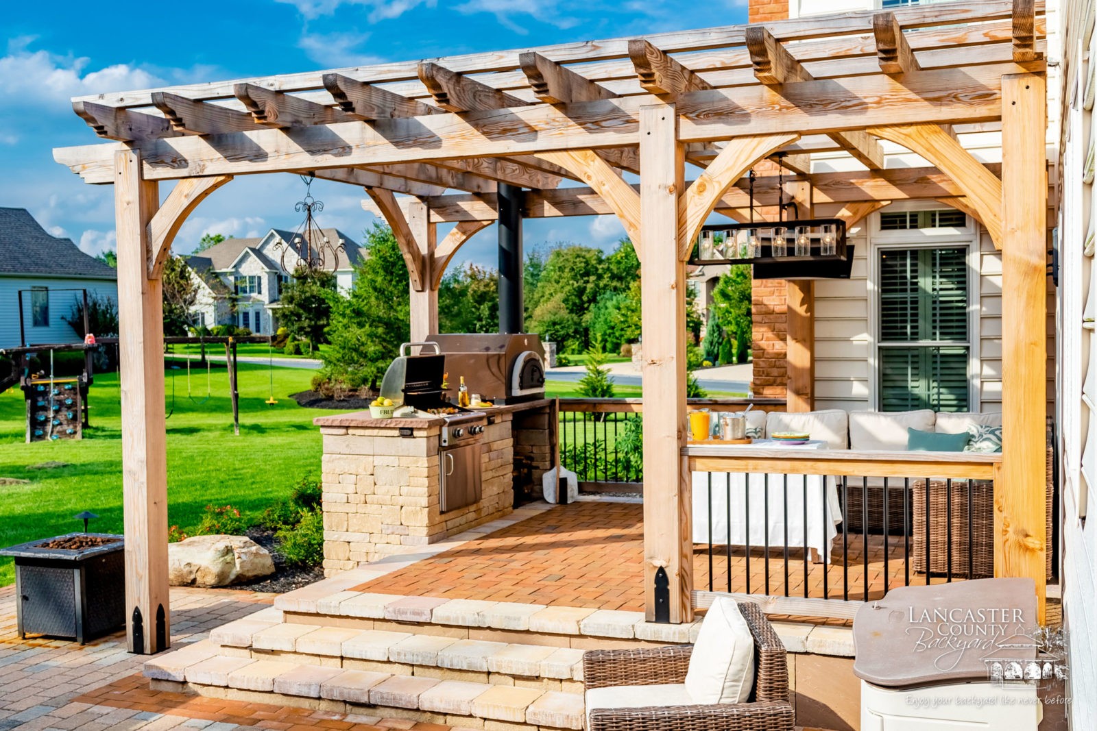 beautiful outdoor kitchen under a pergola
