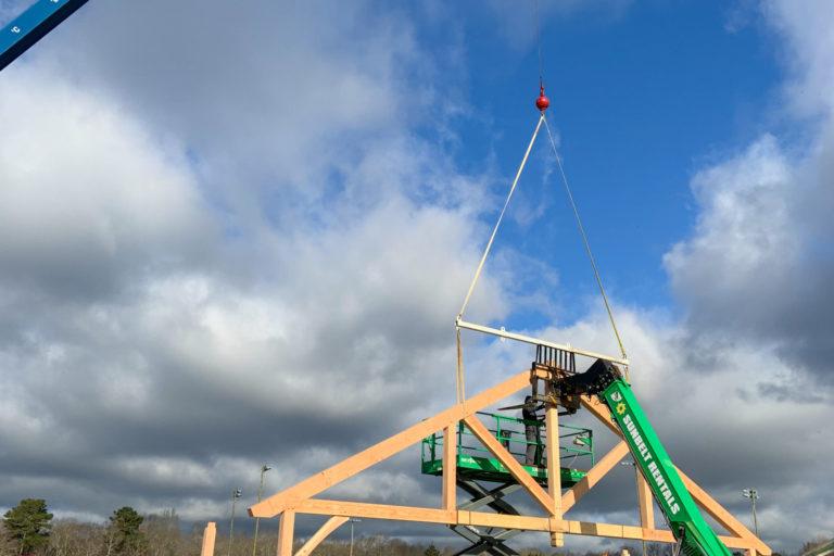 custom kingston timber frame pavilion being set
