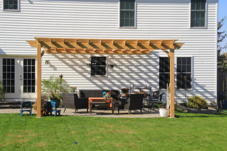 wooden pergola attached to house