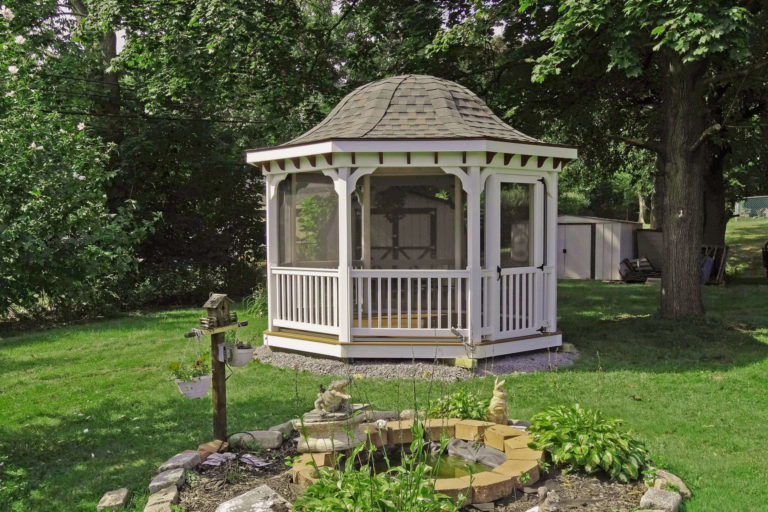 vinyl octagon gazebo in backyard