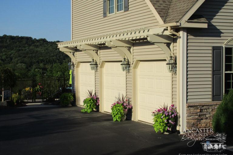 custom pergola over garage doors