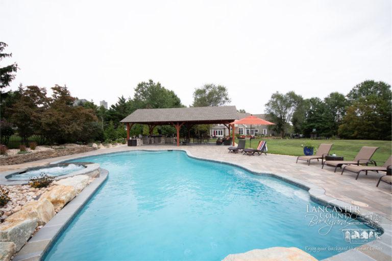 Kingston timber frame backyard pool and patio