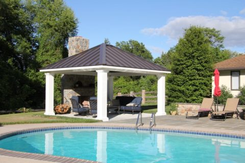 pool side pavilion with outdoor fireplace under pavilion