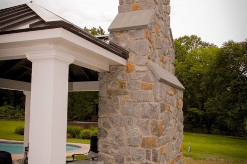 chimney in outdoor fireplace under pavilion