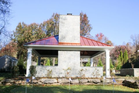 view of chimney in outdoor fireplace under pavilion