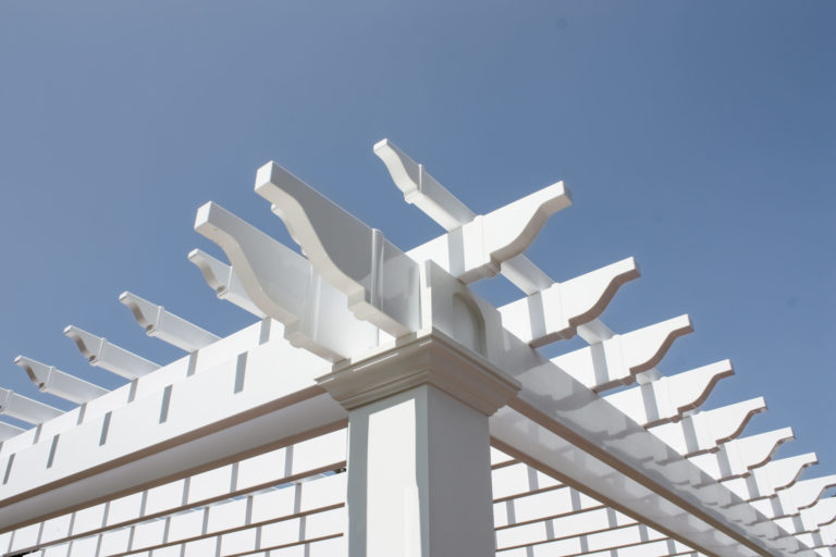 top of a vinyl pergola with slats and beams