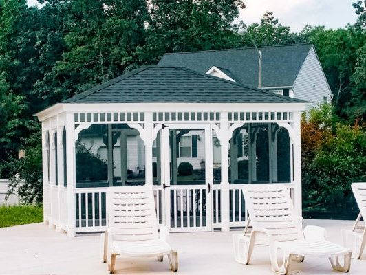 A Permanent Vinyl Gazebo Next To A Pool With 4 Vinyl Outdoor Chairs