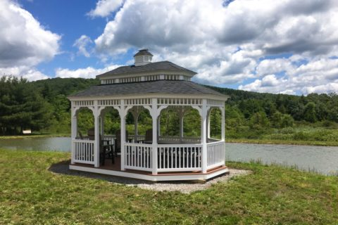 An Irresistible Permanent Gazebo By The Lake At The Backyard