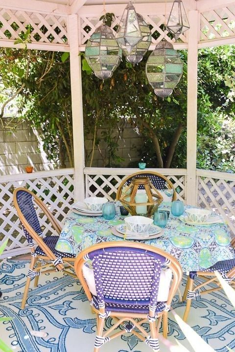 A Permanent Gazebo With Some traditional Outdoor Furniture At The Backyard